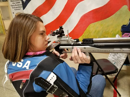 Taylor Farmer takes aim at a 10 meter target at the Gary Anderson Civilian Marksmanship Program Center at Camp Perry in December 2017.