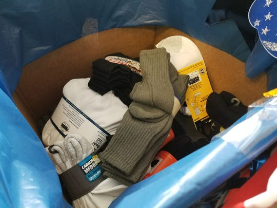 Socks collected by Shoe Sensation to be donated to local military and veterans.