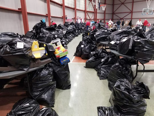 Plastic bags full of toys donated by Toys for Tots