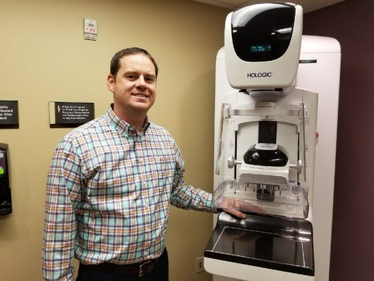 Dr. Nathan Egbert, medical director of radiology for ProMedica Memorial Hospital, explains the 3-D mammography machine.