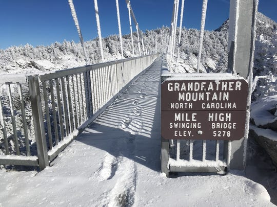 Rime ice at the Mile High Swinging Bridge ushered in a bright and picturesque New Year's Day 2018 at Grandfather Mountain.