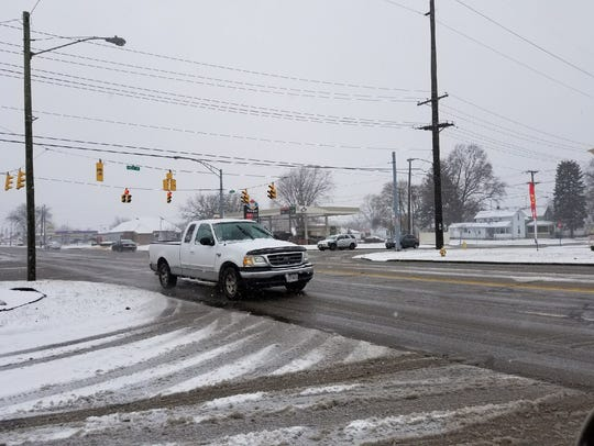 Freezing rain forced schools to close Tuesday for the second day this week.