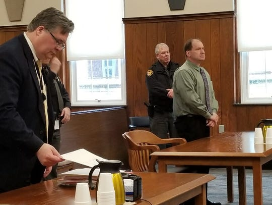 Daniel Myers, right, wears civilian clothes for the first time in Sandusky County Common Pleas Court for a pretrial hearing on Feb. 21.