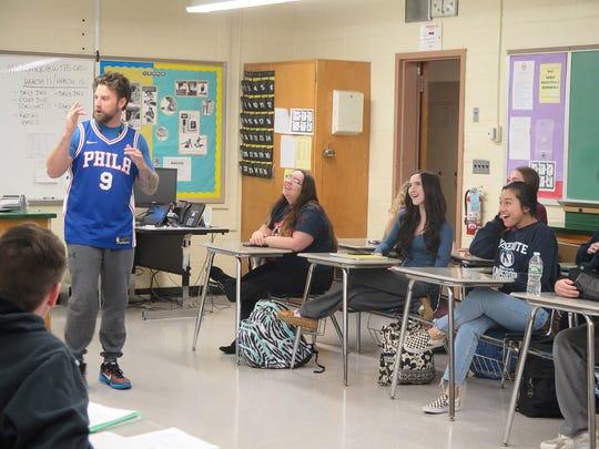 Matt Groark, a health and phys-ed teacher, talks to students in Washington Township High School.
