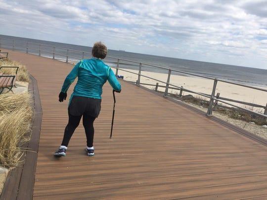 Jamie Watts, who has cerebral palsy, trains on the Long Branch boardwalk on March 10 for the Novo Nordisk New Jersey Marathon.