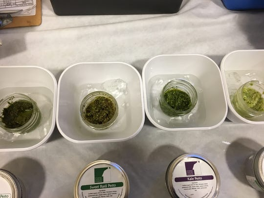 Different kinds of pesto at the Stone House Farm vendor stand at the Local Food Expo in Marshfield at First Presbyterian Church on Thursday.