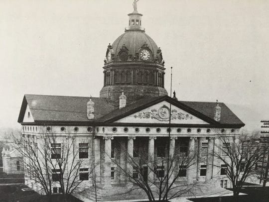 The current Courthouse, with Lady Justice atop, about