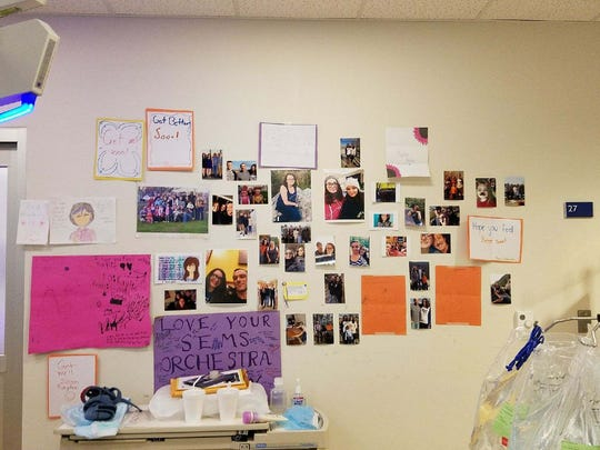 Kaylie Heaton's hospital room wall is covered in pictures