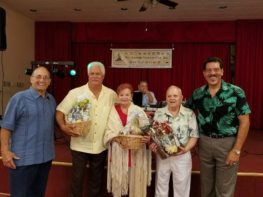 Spanish American Club Baskets of Cheer winners were Carlos Bonet, second from left, Millie Asencio, and Félix Sanabria, flanked by Ruben Aleman and Ray Guadalupe.