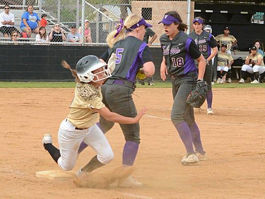 Abilene High's Hannah Lopez trips over Keller Timber