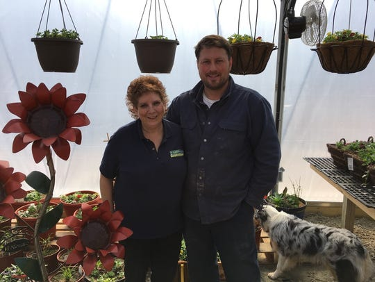 Owners Dusty and Brenda Schlinsog pose inside the recently