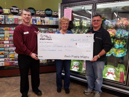 Two Rivers St. Vincent de Paul recently received a donation of $400 from Fox's Piggly Wiggly of Two Rivers. Funds were raised during the annual Christmas Ball Bonanza and will be used to help those in need. Pictured, from left, are: Rob Ullman, Piggly Wiggly store manager; Laurie Cisler, St. Vincent de Paul secretary-treasurer; and board member John Hebel.