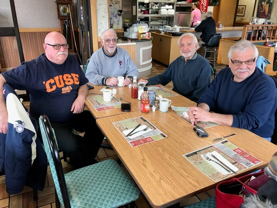 From left: Retired umpires Bob Tokos, Charlie Scarantino, Geno Regni and Rubi meet for breakfast every month at Piccollo's Cafe on Main Street in Binghamton on the third Tuesday of the month. The empty chair was occupied by Joseph Yanuzzi before his death in March.