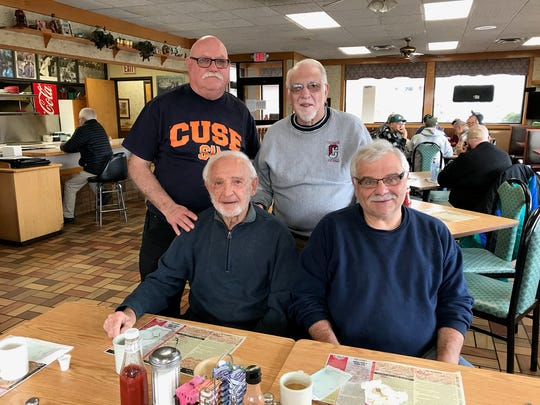 From left: Retired umpires Bob Tokos, Charlie Scarantino,
