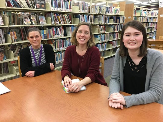 Laura Duffy (far right) is shown at a local library. The Cherokee High student recently completed her Girl Scout Gold Award project. She utilized fundraisers as well as a grant to purchase hundreds of books written in Spanish for the Burlington County Library System.