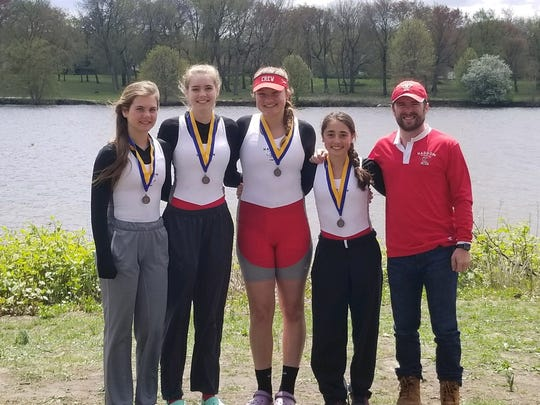 2018 State Champions. HTCC women's freshman quad: (l-r)Olivia Hollingsworth, Fiona Steele, Maya Jacobsen, and Sara Ladik and coach Keith Ferguson at the Garden States Scholastic Championship Regatta at Cooper River.