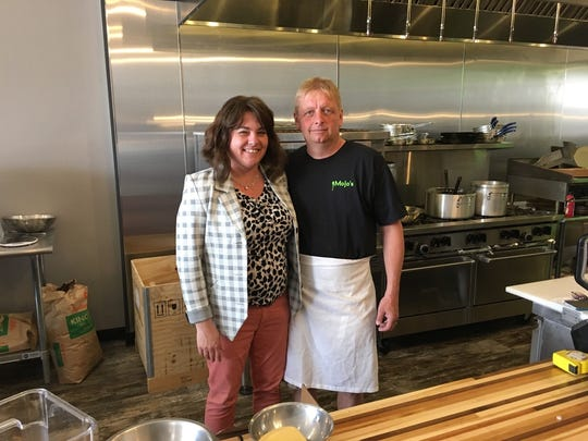 Jen and Matt Olson pose behind the counter at their new restaurant MoJo's Pasta House & Cajun Cook Shack on Thursday, May 17.