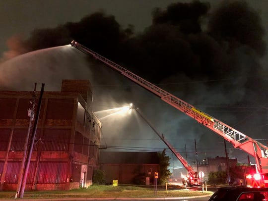 Firefighters battle a blaze at the Chicory Warehouse