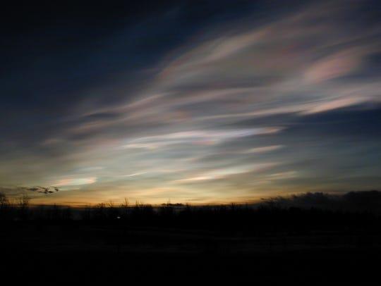 Nacreous clouds lit from below as seen near Kiruna,