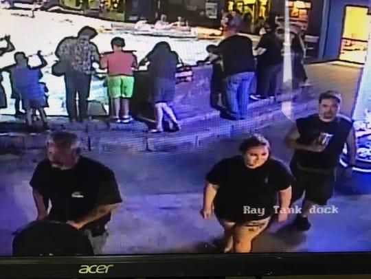 Surveillance footage shows three suspects stealing