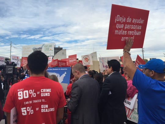 """Protesters gathered at a Brady Campaign event at a """"bad apple gun dealer""""  in central Phoenix."""
