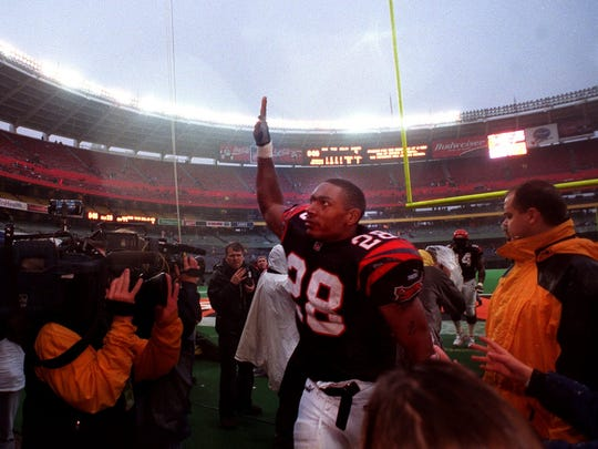 Bengals' running back Coey Dillon, 28, waves to the fans as he leaves Cinergy Field for the last time following the Bengals' win over the Cleveland Browns. Cincinnati Enquirer photo by Gary Landers.