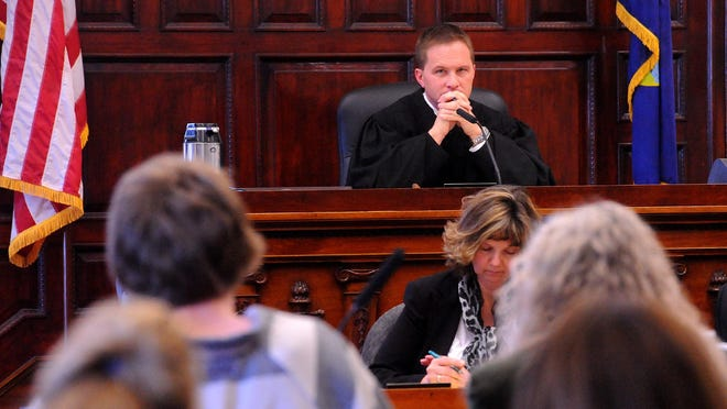District Judge Greg Pinski looks on during witness testimony at the sentencing hearing.