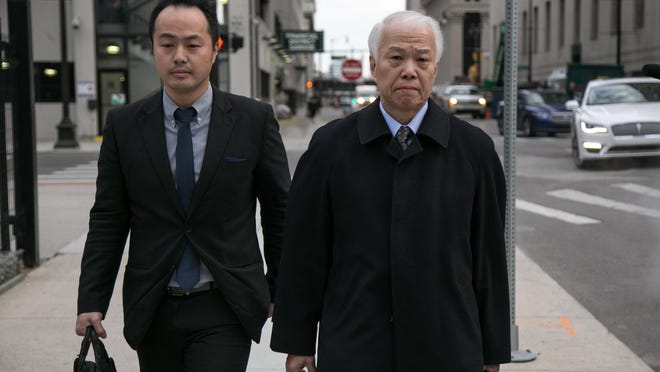 Yoichiro Nomura (right), CFO of Takata Corporation, exits the U.S. District Court in downtown Detroit on Monday February 27, 2017. Takata pled guilty today after being charged with fraud by the U.S. Department of Justice. A federal judge accepted the plea agreement as well as an agreement by Takata to pay up to $1 billion in fines and penalties.