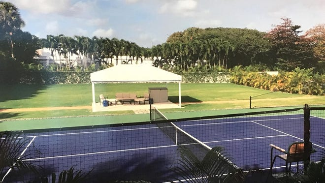A photo presented to the Architectural Commission last year shows John and Margaret Thornton's tennis court. The court was mentioned in a just-settled lawsuit filed against the town by the ownership company of the property next door, the home of Lamia and Bradley Jacobs at 100 Emerald Beach Way.