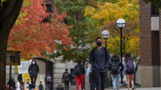 University of Michigan students walk around campus in Ann Arbor on Tuesday, Oct. 20, after Washtenaw County Health Department issued a Stay in Place order for undergrad students because of the rising number of COVID-19 cases on campus.