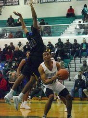 Peabody's Dwight Simon (55) goes up for a shot against