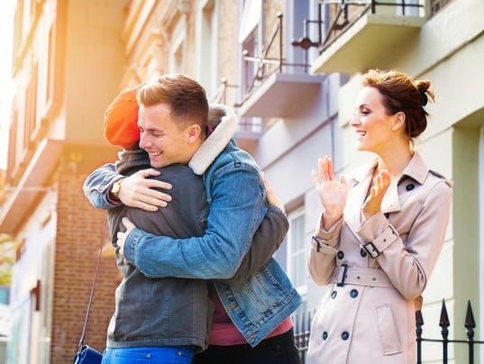 Real estate agent elated as couple hug over home purchase