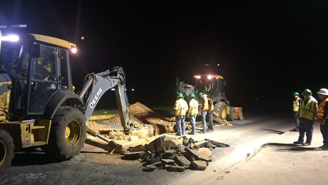 Guam Waterworks Authority crew prepare to repair a damaged sewer line under Harmon Loop Road Wednesday night.
