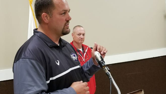 Fremont Ross football coach Chad Long, foreground, and St. Joseph Central Catholic football coach Brian Spicer talk to Kiwanis members about their goals for the 2017 season.