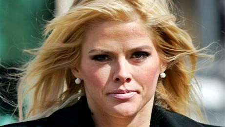 Anna Nicole Smith, leaves the U.S. Supreme Court in Washington, D.C. Smith's final bid to obtain her late husband's money has failed, seven years after her death. A federal judge in Santa Ana, Calif., on Monday, Aug. 18, 2014, rejected a bid by Smith's estate to obtain about $44 million from the estate of J. Howard Marshall II, her late Texas billionaire husband.