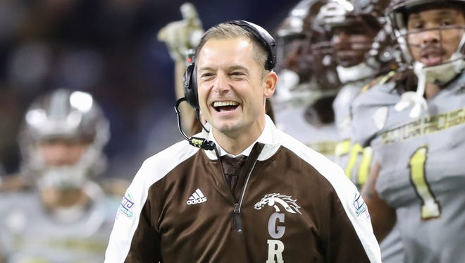 Western Michigan coach P.J. Fleck celebrates after a fumble by Ohio receiver Kyle Belack during the first half of WMU's 29-23 win over Ohio in the MAC title game Friday, Dec. 2, 2016 at Ford Field.