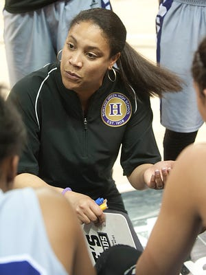 Bowling Green Purples head basketball coach LaVonda L. Johnson talks to her players during a time-out.