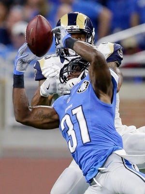 Lions safety Rafael Bush intercepts a pass intended for Los Angeles Rams tight end Lance Kendricks late in the fourth quarter Sunday, Oct. 16, 2016, in Detroit.