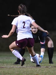 Bowling Green goalie Bailey Cross (1) catches the ball as Henderson's Maddie Tompkins drives toward her during the first round of the Girls State Soccer Tournament played at Colonel Field in Henderson Tuesday, October 24, 2017.