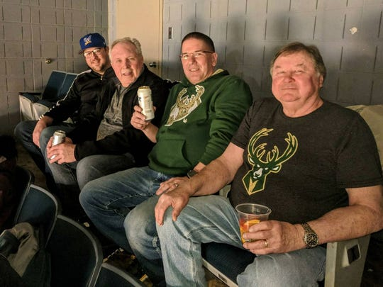 Brian Cieslak, Jim Voss, Mark Kopplin and Rich Cieslak sit in the back row of the BMO Harris Bradley Center during the April 9, 2018 game between the Milwaukee Bucks and the Orlando Magic, the final regular-season game in the venue. Thirty years earlier, with the late John Cieslak in lieu of Brian, the men sat in the same seats (Section 438, Row X) for the first event held there, an exhibition NHL game.