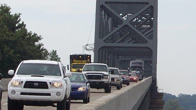 Motorists drive along the U.S. 41 Twin Bridges in Henderson, Kentucky.