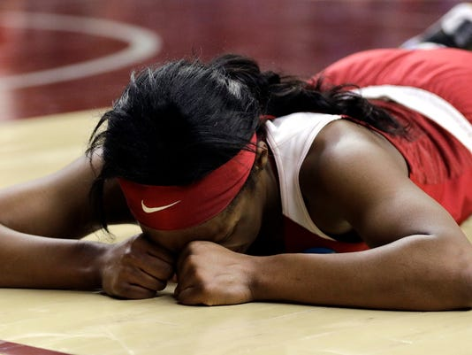 Oklahoma's Shaina Pellington lies on the court after diving for a loose ball against DePaul during the second half of a first-round game in the NCAA women's college basketball tournament in College Station, Texas, Friday, March 16, 2018. DePaul won 90-79. (AP Photo/David J. Phillip)