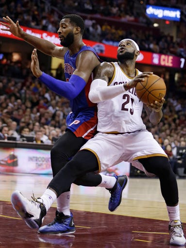 Cleveland Cavaliers' LeBron James, right, drives to