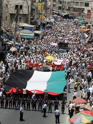 In this July 2012 photo, followers of the Jordanian Muslim Brotherhood movement march during a protest in Amman.