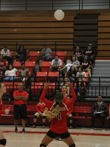 Chasity Onsurez sets a ball for the Lady Falcons Aug.