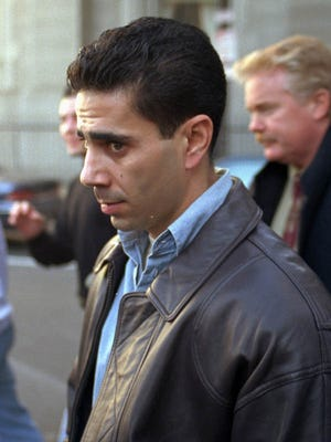Reputed mob figure Joey 'Skinny Joey' Merlino leaves the Criminal Justice Center in Philadelphia during his father's mob murder trial
