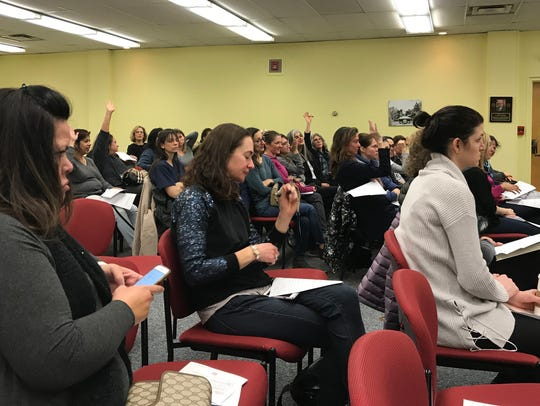 The Essex County affiliate of Moms Demand Action, a nationwide group opposing gun violence, conduct a forum in the Millburn Free Public Library on Tuesday, March 20, 2018.
