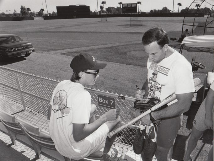 Kerry Reeder, of Tempe, has a baseball card signed