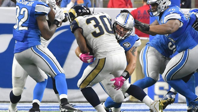 Lions Anthony Zettel picks up Rams running back Todd Gurley cutting through a hole and puts him down to the turf in the third quarter.