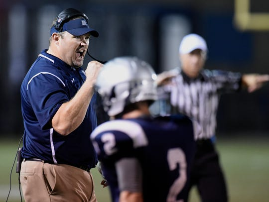 Reitz High football head coach Andy Hape reacts after
